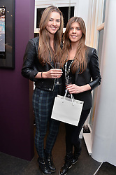 Left to right, sisters LAYLA YOUNG and LEVI YOUNG  daughters of singer Paul Young at a private view of photographs 'Terry O'Neill-The Best Of' held at The Little Black Gallery, 13A Park Walk, London on 16th January 2014.