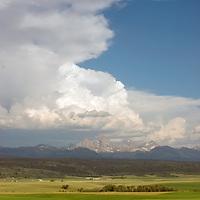 Thunderheads tower over Idaho farmlands under western slopes of the Teton Mountains, between Ashton and Driggs.