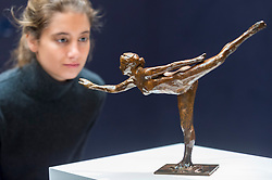"""© Licensed to London News Pictures. 20/02/2019. LONDON, UK. A staff member views """"Danseuse, Arabesque ouverte sur la jambe droite, bras, gauche dans la ligne"""", 1919, by Edgar Degas (Est. £0.6-0.8m).  Preview of Sotheby's Impressionist & Modern and Surrealist Art sales.  The auction will take place at Sotheby's New Bond Street on 26 February 2019.  Photo credit: Stephen Chung/LNP"""