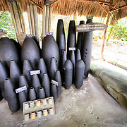 A display of the types of unexploded ordnance recovered from the surrounding area from the American bombing campaign against the Viet Cong in the area during the Vietnam War. The Cu Chi tunnels, northwest of Ho Chi Minh City, were part of a much larger underground tunnel network used by the Viet Cong in the Vietnam War. Part of the original tunnel system has been preserved as a tourist attraction where visitors can go down into the narrow tunnels and see exhibits on the defense precautions and daily life of the Vietnamese who lived and fought there.