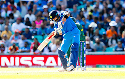 Virat Kohli (capt.) of India   clubs the ball for four through mid wicket
