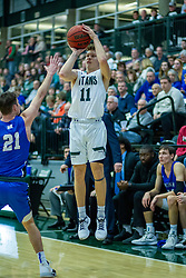 BLOOMINGTON, IL - January 04: Keondre Schumacher shoots for 3 over Zach Fisher during a college basketball game between the IWU Titans  and the Millikin Big Blue on January 04 2020 at Shirk Center in Bloomington, IL. (Photo by Alan Look)
