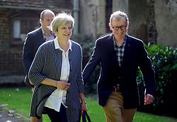 © Licensed to London News Pictures. 20/08/2017.. British prime minister THERESA MAY and her husband PHILIP flanked by security as they attend church . Photo credit: Ben Cawthra/LNP