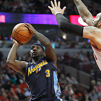 26 March 2012: Denver Nuggets point guard Ty Lawson (3) goes for the jumpshot past Chicago Bulls power forward Carlos Boozer (5) during the Denver Nuggets 108-91 victory over the Chicago Bulls at the United Center, Chicago, Illinois, USA. NOTE TO USER: User expressly acknowledges and agrees that, by downloading and or using this photograph, User is consenting to the terms and conditions of the Getty Images License Agreement. Mandatory Credit: 2012 NBAE (Photo by Chris Elise/NBAE via Getty Images)