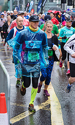 © Licensed to London News Pictures. 23/09/2018. Bristol, UK. The Simplyhealth Great Bristol Half Marathon 2018. Runners compete in the rain on the autumn equinox, the first day of astronomical autumn. Photo credit: Simon Chapman/LNP
