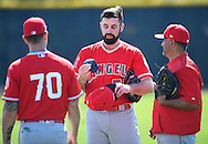 Angels' pitcher Matt Shoemaker shows Tom Gregorio, left, and Steve Soliz his protective insert before facing live BP during workouts at the Angels' Spring Training facility in Tempe, AZ on Wednesday, February 22, 2017. (Photo by Kevin Sullivan, Orange County Register/SCNG)