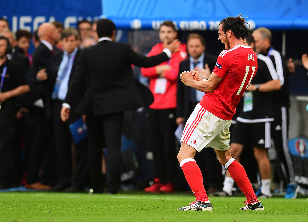 Wales's Gareth Bale celebrates his sides 2-1 victory over Slovakia<br /> <br /> Photographer Kevin Barnes/CameraSport<br /> <br /> International Football - 2016 UEFA European Championship - Group B - Wales v Slovakia - Saturday 11th June 2016 - Nouveau Stade de Bordeaux, Bordeaux<br /> <br /> World Copyright © 2016 CameraSport. All rights reserved. 43 Linden Ave. Countesthorpe. Leicester. England. LE8 5PG - Tel: +44 (0) 116 277 4147 - admin@camerasport.com - www.camerasport.com