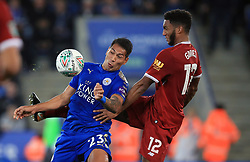 Leicester City's Leonardo Ulloa (left) and Liverpool's Joe Gomez battle for the ball during the Carabao Cup, third round match at the King Power Stadium, Leicester.