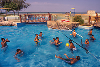 Umm al-Quwain, United Arab Emirates | 2004<br /> Boys play volleyball at a waterpark popular with the local Indian community. Known for its luxury properties and guest workers from South Asia, the UAE has long been a trading hub and home to Indians, even before the oil boom and economic expansion of recent decades. Indians who live in the UAE form the core of the local middle class, owning shops and businesses and building their own schools and social organizations.