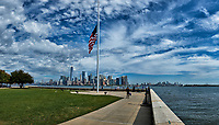 Flag at half-mast and Manhattan skyline from Ellis Island. Composite of 33 images taken with a Fuji X-T2 camera and 18-55 mm zoom lens (ISO 200, 18 mm, f/5.6, 1/4700 sec). Raw images processed with Capture One Pro and AutoPano Giga Pro.