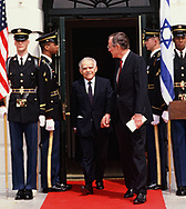 Washington, DC 1989/04/07  President H.W. Bush and Israel Prime Minister at the Diplomatic entrance of the White House for a brief departure ceremony.<br />Photo by Dennis Brack