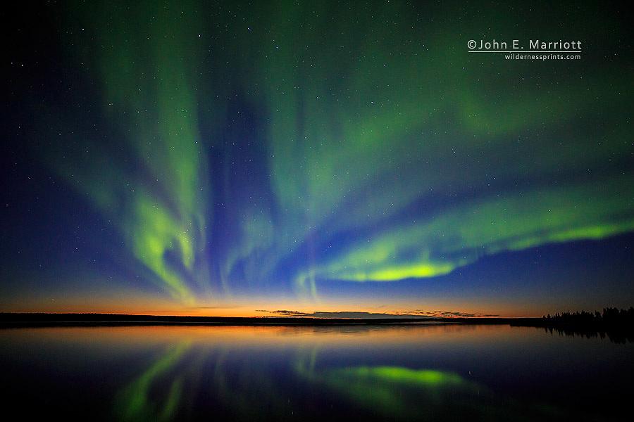 Aurora Borealis over Ennadia Lake, Nunavut, Canada in the Canadian arctic