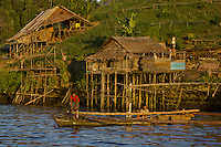 Semi-permanent fishermans camp at Tanjung Besi, Gam Island.  These outsiders from Buton Island, Sulawesi, come here for moths at a stretch to fish at night for small fish...Men prepare to take their boats out for a night of fishing.