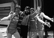 "Brendan Grace with Joggers at The Gaiety Theatre,Dublin 2 Ireland.1982.24.05.1982.05.24.1982.24th May 1982  .Brendan Grace in ""Bottler"" mode takes time out from rehearsals at the Gaiety Theatre. As one of the celebrities taking part in this years CRC ""Jogathon"", he is meeting with some runners from the ""Great Outdoors""who will also take part..From left: Derek O'Connor, ""Bottler"",Tom Hogarty and Jimmy Hayden"