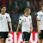 Germany's Mario GOMEZ (L), Bastian SCHWEINSTEIGER (C) and Holger BADSTUBER (R) during their UEFA EURO 2012 Qualifying round Group A matchday 19 soccer match Turkey betwen Germany at TT Arena in Istanbul October 7, 2011. Photo by TURKPIX