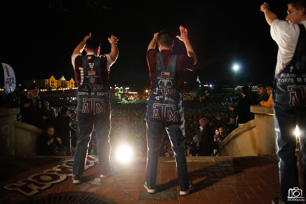 The Fightin' Texas Aggie Yell Leaders perform their midnight Aggie Yell practice traditions with thousands of Texas A&M Aggie fans at Stockyards Station in Fort Worth, Texas, on January 4, 2012.  (Stan Olszewski/The Dallas Morning News)