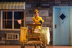 """© Licensed to London News Pictures. 14/05/2014. London, England. Mary Bevan as Despina. Dress rehearsal of the Wolfgang Amadeus Mozart opera """"Così fan tutte"""" at the London Coliseum. A new ENO production of Mozart's dark comedy set in the world of a 1950's Coney Island funfair. With Kate Valentine as Fiordiligi, Christine Rice as Dorabella, Marcus Farnsworth as Guglielmo, Randall Bills as Ferrando, Mary Bevan as Despina and Roderick Williams as Don Alfonso. Directed by Phelim McDermott, Conductor: Ryan Wigglesworth. Co-produced by the English National Opera and the Metropolitan Opera, New York. In collaboration with Improbable. 12 performances from 16 May to 6 July 2014. Photo credit: Bettina Strenske/LNP"""