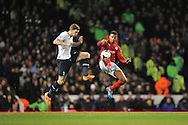 Cardiff's Fraizer Campbell in a mid-air battle with Tottenham's Jan Vertonghen. Barclays Premier League , Tottenham Hotspur v Cardiff city at White Hart Lane in London, England on Sunday 2nd March 2014.<br /> pic by John Fletcher, Andrew Orchard sports photography.