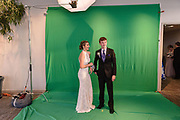 Skyler McMichen and Matthew Madison wait on a green screen to be photographed as Fairdale High School holds it's prom at the Muhammad Ali Center on Saturday, May 18.