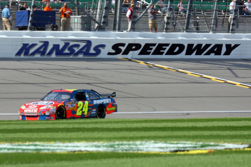 September 26, 2008; Kansas City, KS, USA; Jeff Gordon takes 1 of 2 qualifying laps for the Camping World RV 400 at Kansas Speedway. Mandatory Credit: Douglas Jones-US PRESSWIRE