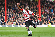 Brentford Midfielder Moses Odubajo (2) takes a shot on goal during the EFL Sky Bet Championship match between Brentford and Queens Park Rangers at Griffin Park, London, England on 2 March 2019.