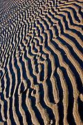 Pattern of sand ripples left on beach at low tide,Devon, U.K.