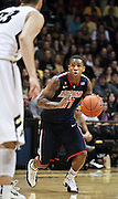 SHOT 1/21/12 6:17:49 PM - Arizona's Josiah Turner #11 dribbles the ball up court against Colorado during their PAC 12 regular season men's basketball game at the Coors Events Center in Boulder, Co. Colorado won the game 64-63..(Photo by Marc Piscotty / © 2012)