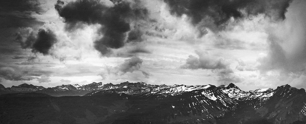Swiss Alps seen from a mountain top - panorama made of four images