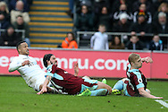 Martin Olsson of Swansea city (l) scores his teams  2nd goal to make it 2-2.   Premier league match, Swansea city v Burnley at the Liberty Stadium in Swansea, South Wales on Saturday 4th March 2017.<br /> pic by Andrew Orchard, Andrew Orchard sports photography.