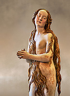 Painted plaster statue of Saint Mary Magdalene, circa 1515-1520, suspended from the vault of the church of St. Mary Magdalene Dominican convent of Augsburg. Inspired by an engraving of Albrecht Durer which depicted Mary Magdalene nude. Inv RF 1338,  The Louvre Museum, Paris. .<br /> <br /> If you prefer you can also buy from our ALAMY PHOTO LIBRARY  Collection visit : https://www.alamy.com/portfolio/paul-williams-funkystock/gothic-art-antiquities.html  Type -   louvre     - into the LOWER SEARCH WITHIN GALLERY box. Refine search by adding background colour, place, museum etc<br /> <br /> Visit our MEDIEVAL ART PHOTO COLLECTIONS for more   photos  to download or buy as prints https://funkystock.photoshelter.com/gallery-collection/Medieval-Gothic-Art-Antiquities-Historic-Sites-Pictures-Images-of/C0000gZ8POl_DCqE