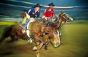 """14 DECEMBER 2002 - LAS VEGAS. NEVADA. USA: Jeff Collins, a bareback rider from Redfield, KS, finishes his ride at the National Finals Rodeo in Las Vegas, NV, Dec 14, 2002. The NFR is the """"super bowl"""" of rodeo and draws hundreds of thousands of rodeo fans to Las Vegas for ten days every December. The rodeo is held at the Thomas and Mack center, which sells out for all ten performances. Other cowboy and western themed events take place around Las Vegas.  PHOTO BY JACK KURTZ"""