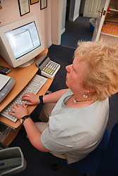 Woman with visual impairment at computer.