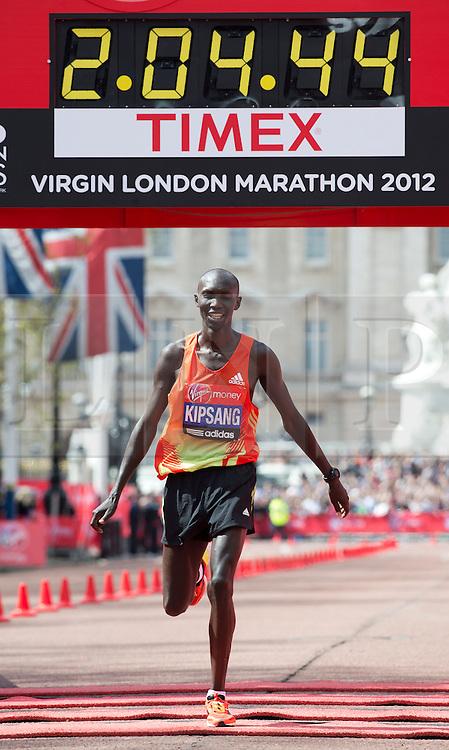 © London News Pictures. 22/04/2012. London, UK. Wilson Kipsang of Kenya crosses the finish line to win the men's elite race during the 2012 Virgin London Marathon on April 22, 2012. Photo credit : Ben Cawthra /LNP