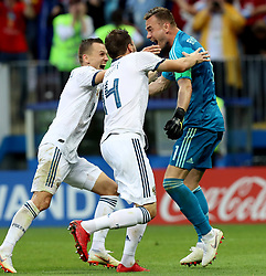 MOSCOW, July 1, 2018  Goalkeeper Igor Akinfeev (R) of Russia celebrates victory with teammates after the 2018 FIFA World Cup round of 16 match between Spain and Russia in Moscow, Russia, July 1, 2018. Russia won 5-4 (4-3 in penalty shootout) and advanced to the quarter-final. (Credit Image: © Yang Lei/Xinhua via ZUMA Wire)