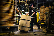 38516 LOUISVILLE, Ky. - Thursday April 30, 2015. - Sherman Carpenter applies metal rings to the oak barrels at the Brown-Forman Cooperage. Bourbon barrels have to be made of American white oak and there have to be enough of them to hold all the new bourbon coming on line, because bourbon must be aged for a minimum of two years. <br /> <br /> William DeShazer for The Wall Street Journal