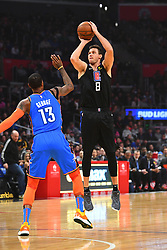 March 8, 2019 - Los Angeles, CA, U.S. - LOS ANGELES, CA - MARCH 08: Los Angeles Clippers Forward Danilo Gallinari (8) shoots over Oklahoma City Thunder Forward Paul George (13) during a NBA game between the Oklahoma City Thunder and the Los Angeles Clippers on March 8, 2019 at STAPLES Center in Los Angeles, CA. (Photo by Brian Rothmuller/Icon Sportswire) (Credit Image: © Brian Rothmuller/Icon SMI via ZUMA Press)
