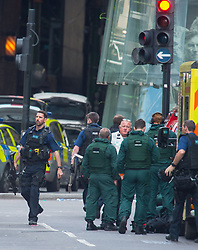 Armed police and emergency services outside Borough Market, London, following last night's terrorist incidents.