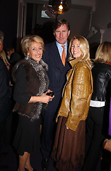 Left to right, The DUCHESS OF MARLBOROUGH and MR & MRS BERTIE WAY, a former close friend of Koo Stark at a party hosted by jeweller Theo Fennell and Dominique Heriard Dubreuil of Remy Martin fine Champagne Cognac entitles 'Hot Ice' held at 35 Belgrave Square, London, W1 on 26th October 2004.<br /><br />NON EXCLUSIVE - WORLD RIGHTS