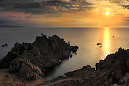 Cala Grande, one of the many small bays of the amazing rocky promontory known as Capo Testa, just off Santa Teresa di Gallura in Sardinia, Italy. Taken about 30 minutes after sunset on a wonderful evening of mid September. Stitched from six vertical frames.