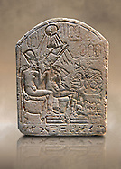 Ancient Egyptian limestone funerary stele showing Akhenaten and Nefertiti in front of an offering table. Ancient Egypt 18th Dynasty, 1345 BC. Neues Museum Berlin Cat No: AM 17813. .<br /> <br /> If you prefer to buy from our ALAMY PHOTO LIBRARY  Collection visit : https://www.alamy.com/portfolio/paul-williams-funkystock/ancient-egyptian-art-artefacts.html  . Type -   Neues    - into the LOWER SEARCH WITHIN GALLERY box. Refine search by adding background colour, subject etc<br /> <br /> Visit our ANCIENT WORLD PHOTO COLLECTIONS for more photos to download or buy as wall art prints https://funkystock.photoshelter.com/gallery-collection/Ancient-World-Art-Antiquities-Historic-Sites-Pictures-Images-of/C00006u26yqSkDOM