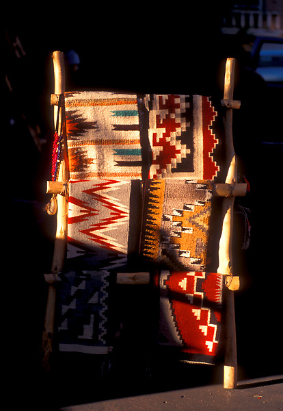 Native American Woven Rugs Hanging on Wooden Rack