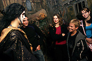 An dressed-up actor is playing with some visitors at the London Dungeon, England, on Thursday, Oct. 12, 2006. The London Dungeon is a live theatre attraction where visitors are taken by the actors through different areas featuring the darkest parts of British history. Some of the more than 40 exhibits include 'The Great Fire of London', 'Jack the Ripper', 'Judgement Day', 'The Torture Chamber', 'Henry VIII', 'The Tower of London' and 'The French Revolution'. In 2003 a new part opened focused on the Great Plague of 1665.    **Italy Out**..