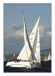 Yachting- The start of the Bell Lawrie Scottish series 2002 at Gourock racing overnight to Tarbert Loch Fyne where racing continues over the weekend.<br /><br />Tartan Revolution GBR9203R Projection920 Class 3 crosses in front of Enigma Sigma 36 GBR3926 class 4.<br /><br />Pics Marc Turner / PFM