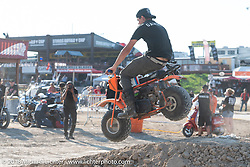 Having fun on the dirt track in front of the Buffalo Chip stage during the 78th annual Sturgis Motorcycle Rally. Sturgis, SD. USA. Tuesday August 7, 2018. Photography ©2018 Michael Lichter.