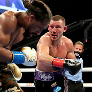 HOLLYWOOD, FL - APRIL 17:  Liam Williams lands a punch to the face of Demetrius Andrade during the WBO Middleweight Championship fight at Seminole Hard Rock Hotel & Casino on April 17, 2021 in Hollywood, Florida. (Photo by Alex Menendez/Getty Images) *** Local Caption *** Demetrius Andrade; Liam Williams