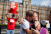 Two men kiss and declare their love in front of religious protesters. The moment when it is announced that the Same Sex Marriage bill had been passed. London Gay Chorus and supporters of the bill celebrate outside the House of Lords. The campaign for the bill has lasted decades. Summary of the Marriage (Same Sex Couples) Bill 2012-13 to 2013-14<br /> A Bill to make provision for the marriage of same sex couples in England and Wales, about gender change by married persons and civil partners, about consular functions in relation to marriage, for the marriage of armed forces personnel overseas, and for connected purposes.