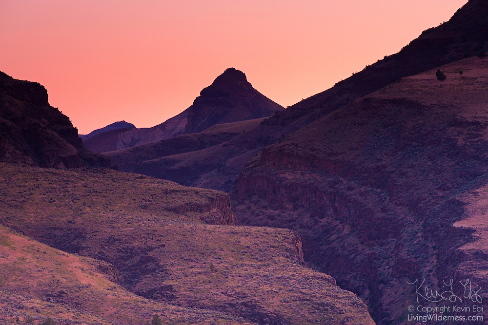 Sheep Rock, the tall mountain at the center of the frame, towers over Picture Gorge in John Day National Monument, Oregon, at sunrise. The moutain was named for the bighorn sheep that used to live in the area.