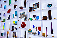 LED Lighted wall of glass products in the Hamilton Building Museum Shop, Denver Art Museum, Denver, Colorado USA.