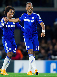 Willian of Chelsea and Didier Drogba of Chelsea celebrate after Didier Drogba scored second goal for Chelsea during football match between Chelsea FC and NK Maribor, SLO in Group G of Group Stage of UEFA Champions League 2014/15, on October 21, 2014 in Stamford Bridge Stadium, London, Great Britain. Photo by Vid Ponikvar / Sportida.com