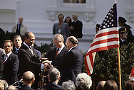 President Jimmy Carter, President Anwar Sadat, and Prime Minister Menachem Begin during a signing ceremony on the North Lawn of the White House in April , 1980<br /> <br /> Photograph by Dennis Brack<br /> bb45